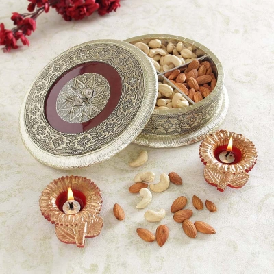 Kaju and Almonds in Round Metal Box with Diyas