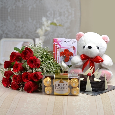 1/2 kg Chocolate Cake with Teddy Bear and 12 Roses
