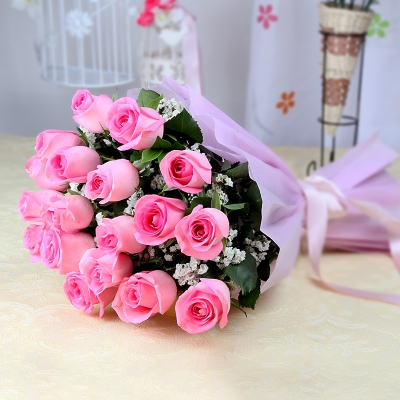Pink Roses in Tissue Paper Wrapping with Ribbon