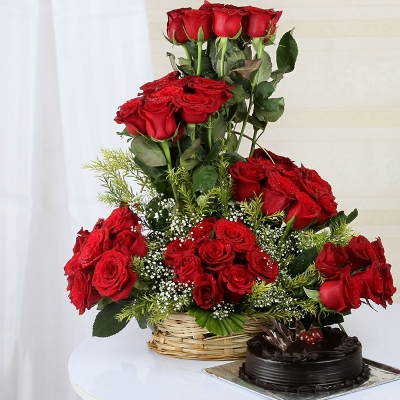 Red Roses Arranged in Round Basket with Cake