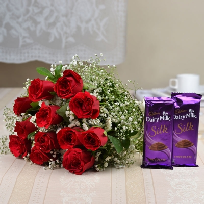 Dairy Milk Silk with 12 Red Roses Bunch