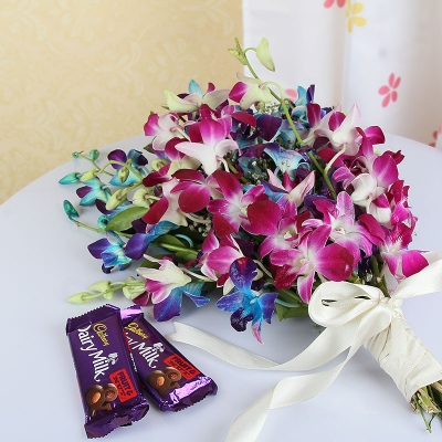 Purple and Blue Orchids with Cadbury Chocolates