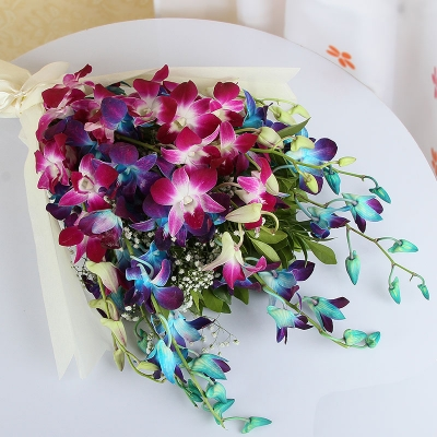 Purple and Blue Orchids in Tissue Paper Wrapping