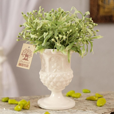 White Ceramic Pot with Green Artificial  Leaves