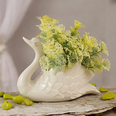 Yellow Artificial Flowers in White Ceramic Swan Pot