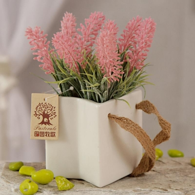 Pink Artificial Flowers in White Ceramic Pot