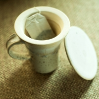 Handcrafted Studio Pottery Green Tea Filter Mug In Creamish Whit