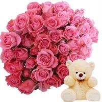 A Cute Teddy with Pink Roses of Surprise
