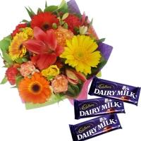 Mix Seasonals Flowers with DairyMilk Chocolates