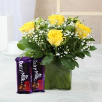 Yellow Roses Arranged in Vase and Dairymilk Fruit n Nut