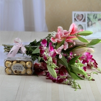 Fresh lilies and orchids and ferrero rocher