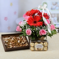 Twelve Flowers Arranged in Basket with Dryfruits and Chocolates