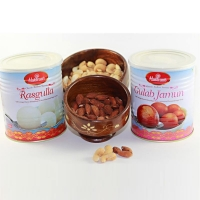 Rasgulla and Gulab Jamun with Nuts in Wooden Bowls for USA