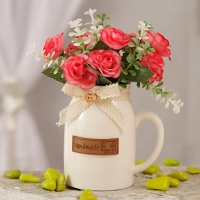 Red Artificial Flowers in Ceramic Mug