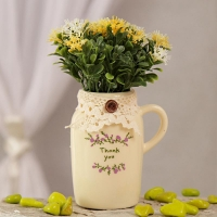 Jug Shaped Pot with Yellow Flowers and Leaves