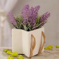 Purple Artificial Flowers in White Ceramic Pot