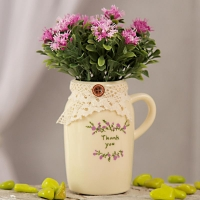 Purple Flowers in Ceramic Jug shaped Pot